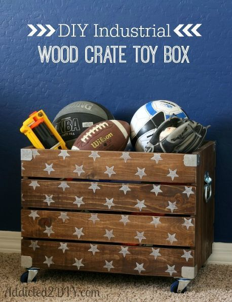 Wooden Crate With White Stars On Wheels Full Of Sports Equipment In Front Of Blue Wall