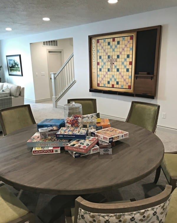 Circle Wood Table With Board Games In Center, Board Game On Wall