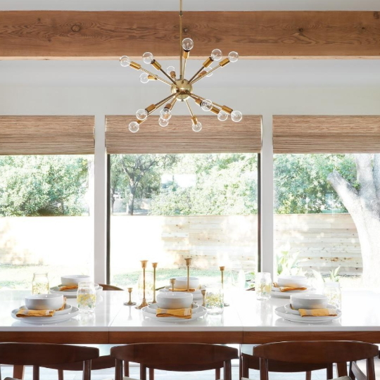 Mid Century Modern Dining Room With Wooden Table And Open Windows