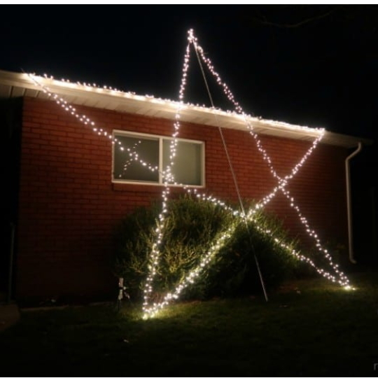 Red Brick House With Giant Star Made Out Of Christmas Lights