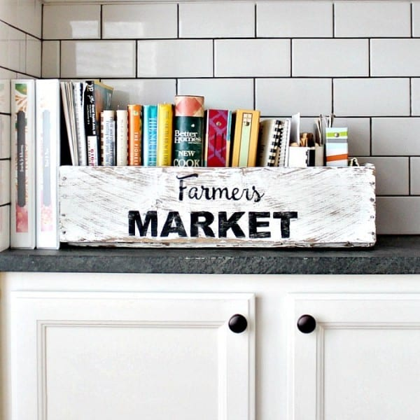 White Kitchen With White Wood Box Labeled Farmers Market Full Of Cook Books