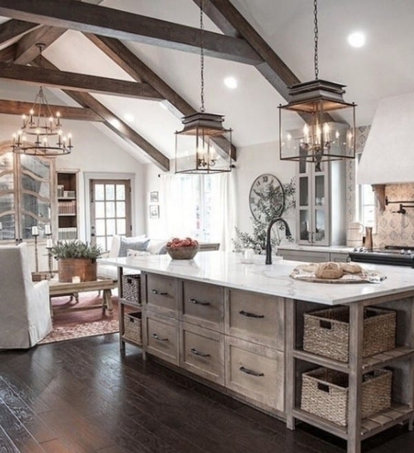 Wooden Farmhouse Kitchen With Drawers And Shelves In Island With Baskets And Stunning Ceilings And Light Fixtures