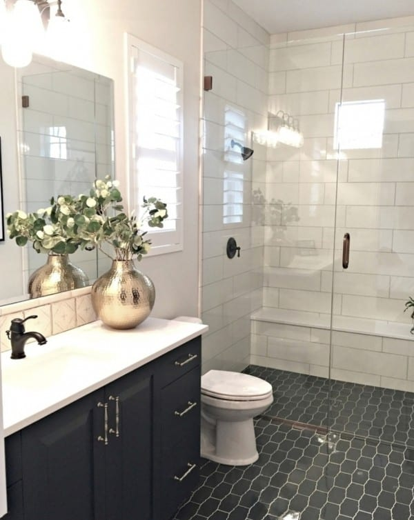 Bathroom With Tiled Floor And Walls Walk Out Shower And Gold Accent Flower Pot