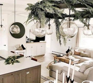 Kitchen With Circle Light Fixture Covered In Tree Branches Making It Festive And Beautiful