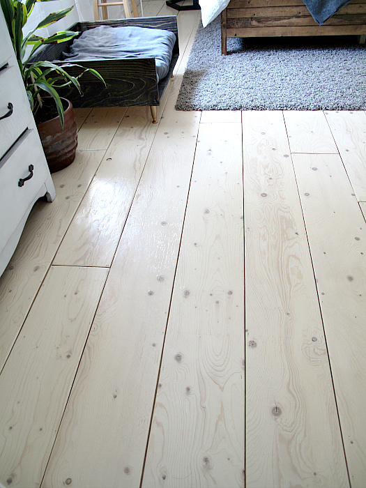 Wooden Floor With Corner Of Dresser, Plant, Rug And Bed, Reviewing The Pros And Cons Of The Flooring