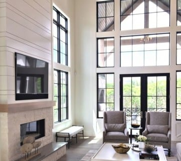 White Living Room With Fireplace And Windows