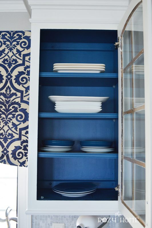 Kitchen Cabinets With Glass Door And Painted Blue On The Inside