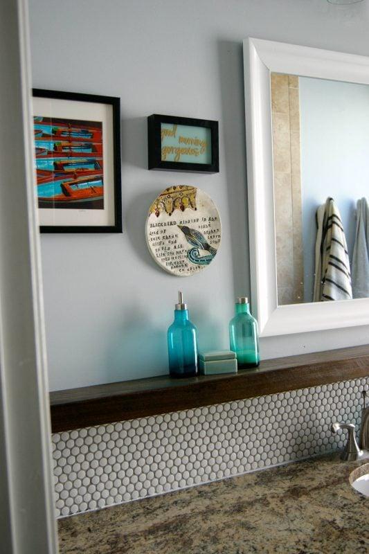 Bathroom Vanity With Penny Tile Backsplash And Floaring Shelf