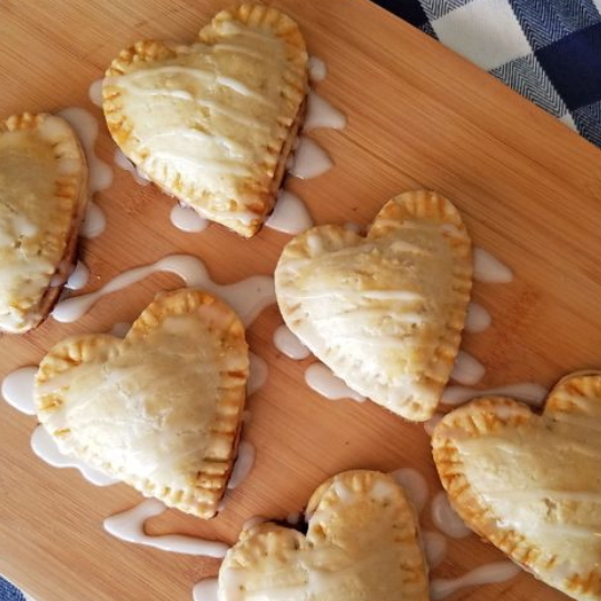 Beautiful Individual Heart Shaped Blackberry Pies, Mini Pies, With Frosing Drizzled On Top