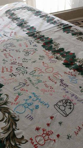 Christmas Tablecloth With Cross Stitch Signatures Added To It