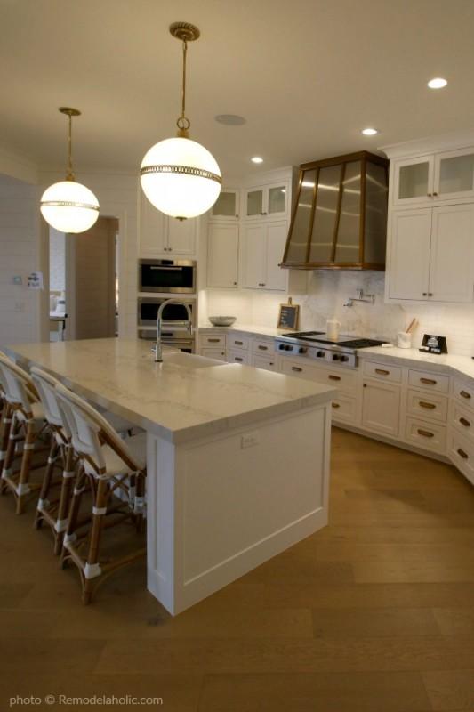 Modern Farmhouse Kitchen Island, Pendant Lighting, White Cabinets, White Backsplash, Copper Range Hood #Remodelaholic