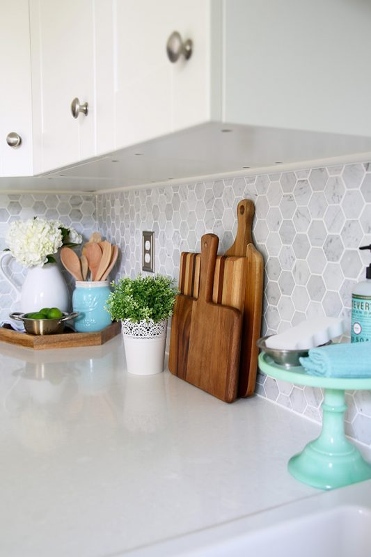 Neutral Backsplashes Image Of Kitchen With White Cabinets And Silver Handles And Grey Backasplash And Accents Of Wood And Torqouise