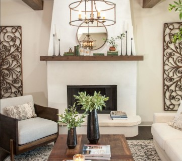 Neutral Living Room With Wooden Beams In The Ceiling And Metal Accents And Wooden Coffee Table