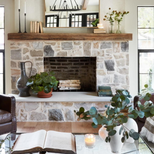 Rock Fireplace With Wooden Shelf And Plants