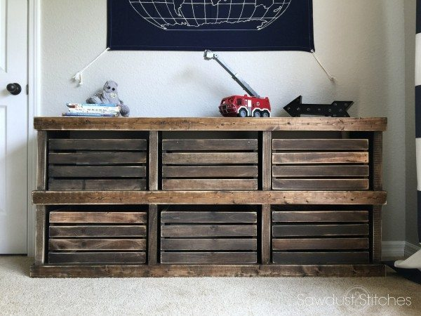 Stained Wooden Cubbies With Wooden Boxes In Each Cubby