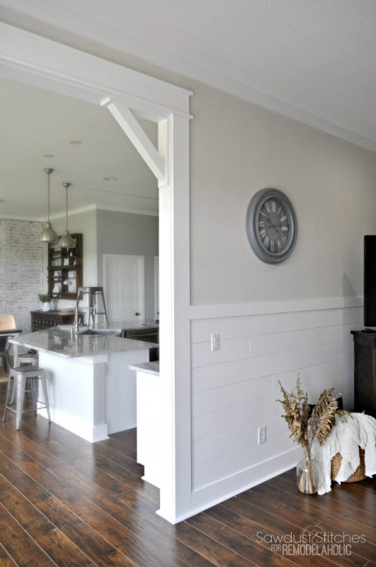 Stained Hardwood Floors With White Plank Walls On Botom Half, Cream Paint And Metal Accents