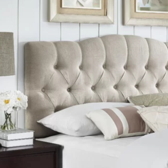 Tufted Cream Headboard With White Planked Wall Behind