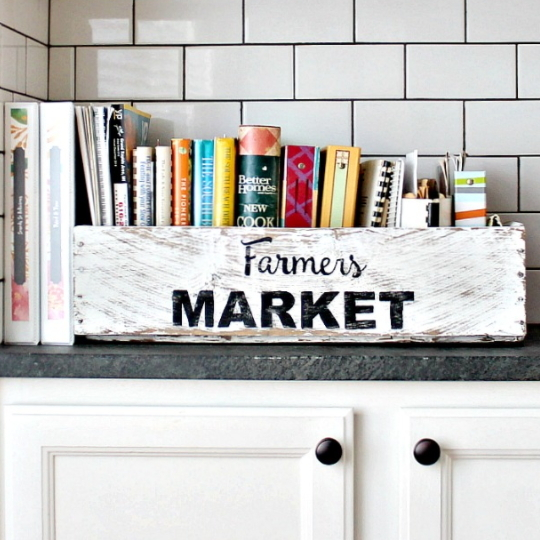 Wooden Basket Painted White With Farmers Market On The Side And Filled With Cook Books