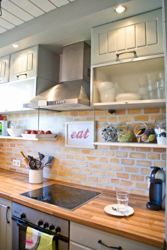 Tiny Kitchen Renovation With Faux Painted Brick Backsplash And Wooden Counters And Open Shelves