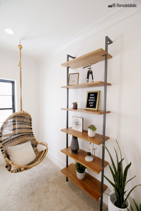 A cute compliment to an office with a striped rattan chair and styled shelves. SGPH 2019 House 24 K Welch Homes, photo by Remodelaholic.com