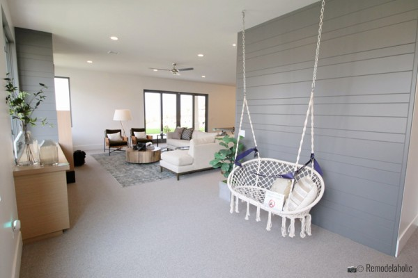 Light Gray shiplaped wall with hanging chair, SLPH 2018 Home 14 Magleby Communities, Photo by Remodelaholic