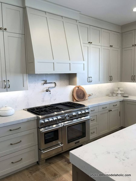 Light Gray Kitchen Cabinets With Range Hood, Tall Cupboards, White Countertops, SLPH 2018 Home 13 Magleby Communties