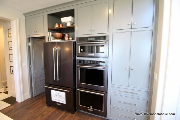 Modern Farmhouse Gray Kitchen Cabinetry With Open Shelves Above Fridge, UVPH 2018 Home 16 Arive Homes