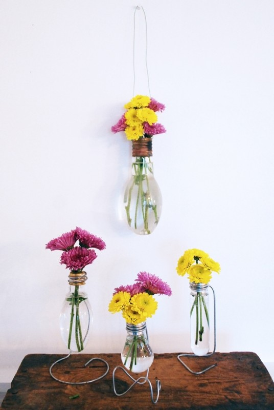 Glass And Metal Flower Vases With Bright Pink And Yellow Flowers