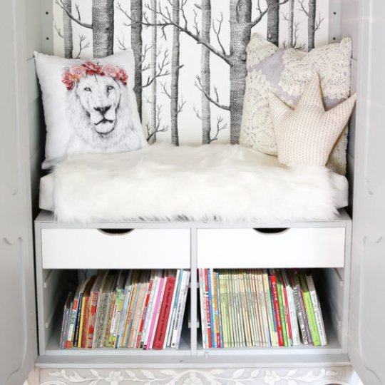Reading Nook With Trees And Faux White Fur And Lion Pillow, Crown Pillow, Drawers And Books