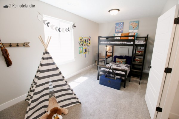Cut little boy room with a blue storage trunk for storing toys, SLPH 2018 Home 10 Hardrock Homes, photo by Remodelaholic