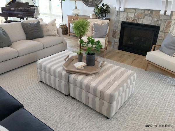 Striped storage trunks as a coffee table in a living room, SLPH 2018 Home 13 Magleby Communties, photo by Remodelaholic