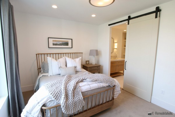 Wood spindle headboard and footboard in the master bedroom, SLPH 2018 Home 13 Magleby Communties, Photo by Remodelaholic