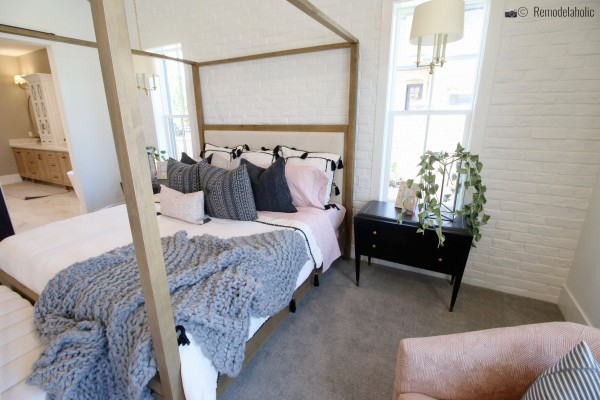 Pretty natural wood four poster upholstered bed in a pretty master bedroom, UVPH 2018 Home 17 Millhaven Homes, Four Chairs Furniture & Design, Photo by Remodelaholic