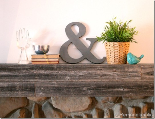 DIY Ampersand Decoration On Natural Wood Shelf With Books And Flower