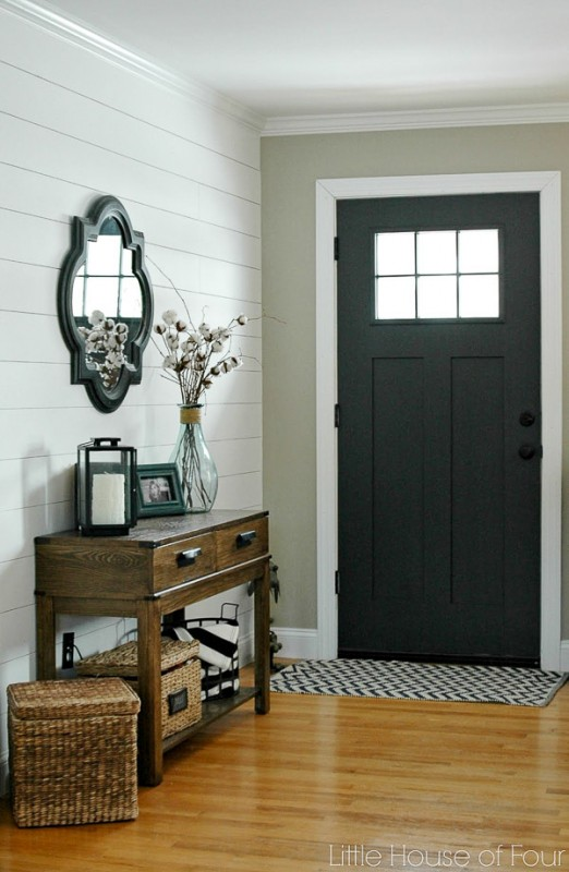 Entryway With White Shiplap Accent Wall, Wooden Long Table, Black Front Door, Accent Rug And Wood Floor