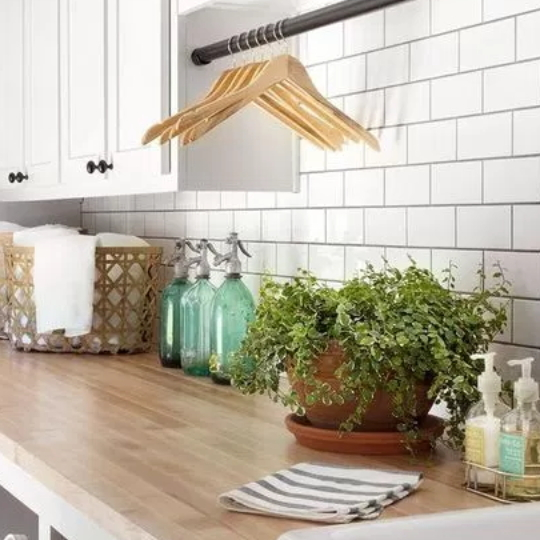 Modern Farmhouse Laundry Room Inspiration With White Brick Walls, Wood Cupboard, Gold Metal Accents