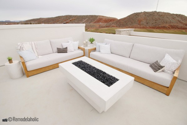 Outdoor sofas around a beautiful fire table, SGPH 2019 House 03 Cole West Resorts LLC, Photo by Remodelaholic