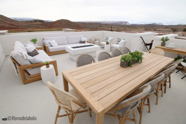 Build an outdoor dining table around a fire pit and add comfy seating and a dining area, SGPH 2019 House 03 Cole West Resorts LLC, Photo by Remodelaholic