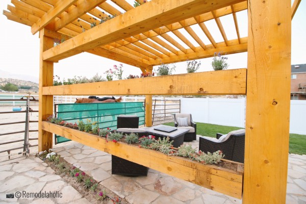 Pergola with planter boxes and seating area, SLPH 2018 Home 17 Green Haven Homes, Photo by Remodelaholic