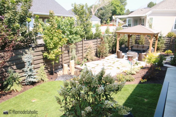 A shaded pergola area is perfect in a gorgeous landscaped yard, SLPH 2018 Home 3 Breen Homes, Photo by Remodelaholic