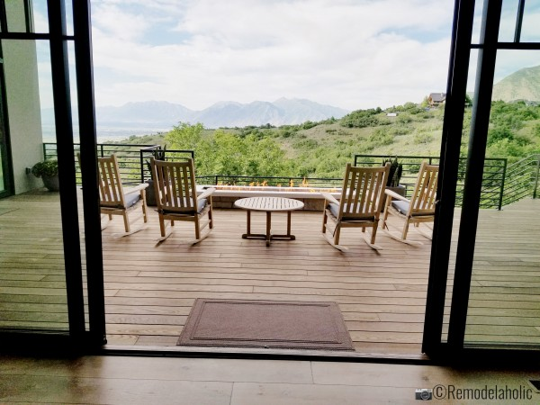 Rocking chairs, a view, and a long rectangle fire table, UVPH 2018 Home 2 Split Rock Fine Homes, Photo by Remodelaholic