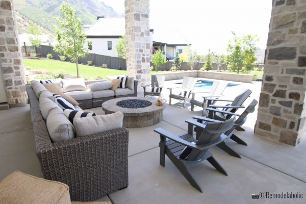 Fire pit with and outdoor sectional and lots of seating, UVPH 2018 Home 33 E Builders, Erin Hansen Design, Photo by Remodelaholic