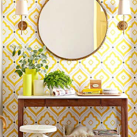 Yellow Wallpaper With Circle Mirror And Wooden Entry Table And Yellow Vase