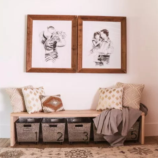 Entryway With Wooden Bench And Metal Numbered Bins Beneath With Family SKetches Above