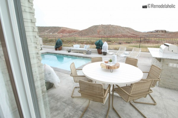 Pretty white and tan patio set. SGPH 2019 House 03 Cole West Resorts LLC, Photo by Remodelaholic