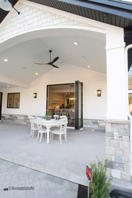 Pretty covered patio with fan and table. SLPH 2018 Home 6 Bradshaw Homes & Property, Photo by Remodelaholic