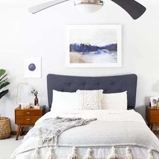 White And Blue Bedroom, Blue Headboard, White Bedding, Wood Side Tables And Blue And White Artwork On The Walls