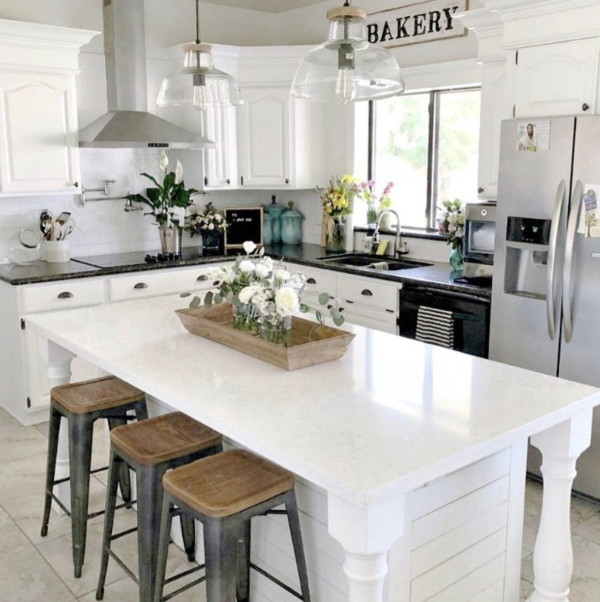 Farmhouse Kitchen With White Island, Counters, And Wall And Natural Wood Accents