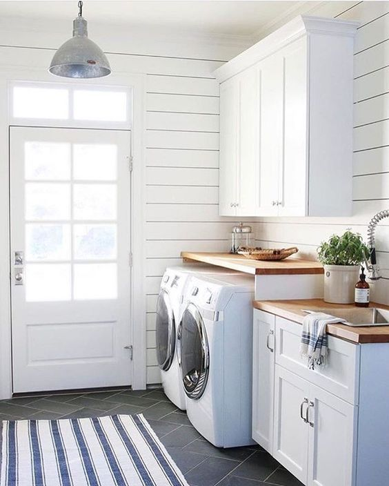 Farmhouse Laundry Room With White Shiplap Walls, White Cupboards With Wood Countertops