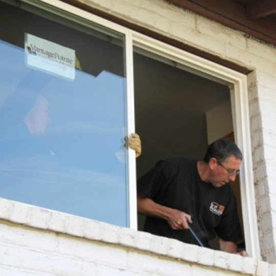 Help When SHopping For New Windows, Brick Building With Man Working On The Window